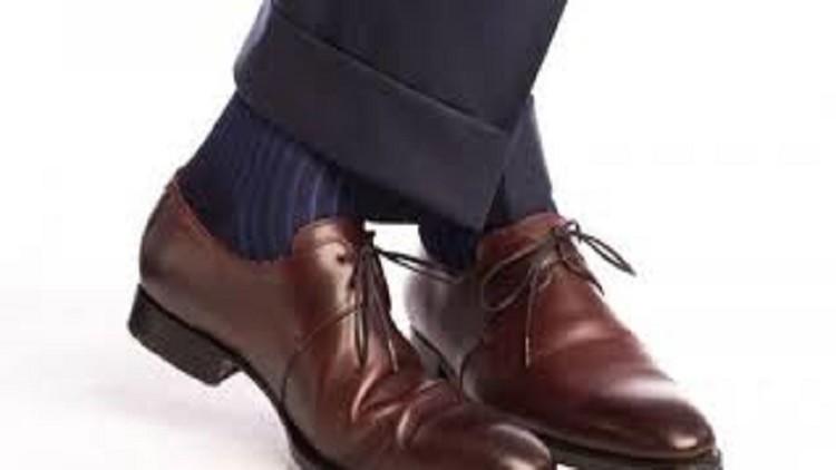 الحذاء البني قد يجعلك عاطلا عن العمل في لندن